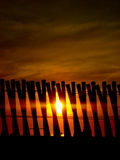 Sunset behind wooden fence - Security - Background Royalty Free Stock Photo