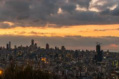 Sunset of Beirut Capital of Lebanon. This is a capture of the sunset in Beirut capital of Lebanon with a warm orange color, and you can see Beirut downtown in stock photos