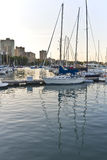 Sunset at Belmont Harbor , Chicago Illinois. Belmont Harbor, on Lake Michigan, in Chicago Illinois, near Lincoln Park, with sail boats and small water craft stock photography