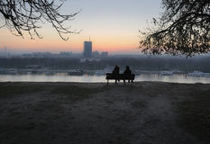 Sunset from the bench. Sunset view from fortress and park Kalemegdan on river Sava and Belgrade city in Southeast of Europe Serbia. Park and fortress Kalemegdan Royalty Free Stock Images