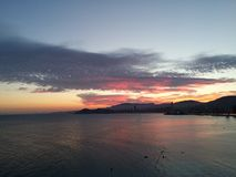 Sunset in Benidorm, Spain. Blue and pink sky above sea royalty free stock images