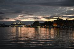 Sunset at Beren in Norway, highlighted harbor and cruise ship. N stock photo