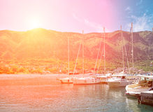 Sunset at the berth. Yachts on sunset at the berth, with mountains on the background Stock Photos