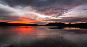 Sunset at Big Bear Lake, California. A fiery red sunset makes for a dramatic image in this shot of Big Bear Lake in California Royalty Free Stock Photo