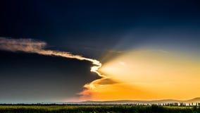 Sunset. With big cloud and half sun Stock Photos