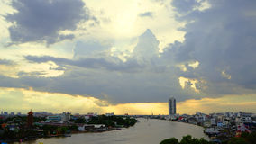 Sunset with big dark clouds on the river at Bangkok. Rain will coming soon Stock Photo