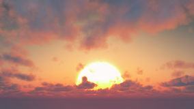 Sunset - big sun and cumulus clouds Stock Images
