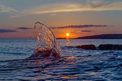 Sunset with a big wave in foreground Stock Photography