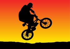 Sunset biker jumping. Vector of a sunset biker jumping Royalty Free Stock Photo