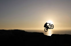 Sunset biker jumping Stock Photo