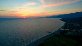 Sunset from a bird`s flight over. A calm sea Stock Image