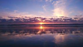 Sunset. Birds, sun, sand, tranquility, grandeur, sea, waves, clouds, sky, beautiful, reflection Stock Image