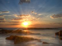 Sunset  at Birubi Beach, Australia. Sunset at Birubi Beach in NSW, Australia, sun in full view Royalty Free Stock Images