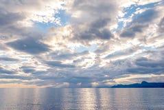 Sunset on the Black Sea coast in Crimea. Cloudy sky Royalty Free Stock Photos