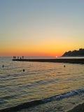 Sunset on the Black Sea, the fishermen on the pier, coast Sochi, Russia Royalty Free Stock Photos
