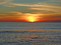 Sunset on the Black Sea, sun and beautiful colorful clouds Royalty Free Stock Photo