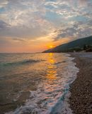 Sunset on the Black Sea with the sun. Georgia, Abkhazia. Colorful sunset with waves. Sunset on the Black Sea with the sun stock photo