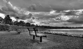 Sunset in Black and White. Empty Park Benches during Sunset over a reservoir stock photo