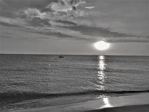 Sunset In Black And White. Colombian Fisherman Return home At Black N` White Sunset Stock Images