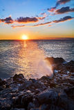 Sunset and blowhole Stock Photography
