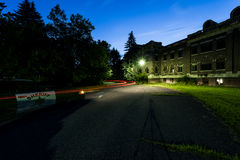 Sunset / Blue Hour / Dusk with Police Car - Abandoned Hospital stock image