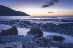 Sunset at the blue hour on the horizon and in the foreground a c royalty free stock photography