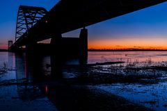 Sunset / Blue Hour at Paducah Steel Tied Arch Bridge - Ohio River, Kentucky & Illinois. An sunset / blue hour view of the Paducah steel tied arch bridge that Stock Photography