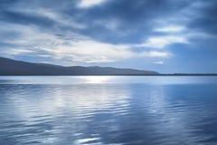 Sunset blue landscape. Orbetello lagoon, Argentario, Italy. Royalty Free Stock Photography