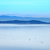 Sunset blue Landscape on Trasimeno Lake, Italy. Stock Photos
