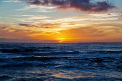 Sunset in the blue sea Royalty Free Stock Image