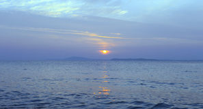 Sunset on blue sea Stock Photography