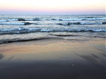 Sunset blue sea waves beach. Pink nature relax Stock Photo