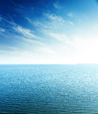 Sunset in blue sky over sea. aerial view Royalty Free Stock Image