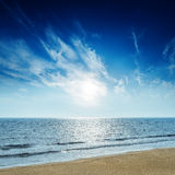 Sunset in blue sky over sea Stock Image
