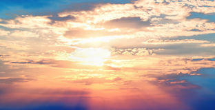 Sunset blue sky red sun Stock Photography
