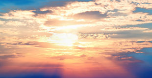 Sunset blue sky red sun Stock Photo
