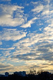 Sunset blue sky and white clouds over city. Vertical landscape with sunset blue sky and white clouds over city taken in Kharkiv, Ukraine Royalty Free Stock Images
