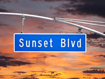 Sunset Blvd Overhead Street Sign with Dusk Sky. Sunset Blvd overhead street sign with sunset sky Royalty Free Stock Photography
