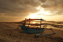 Sunset boat. Boat on a tropical beach during the sunset Royalty Free Stock Photography