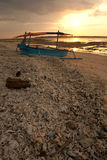 Sunset boat. Boat on a tropical beach during the sunset Royalty Free Stock Photos