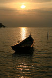 Sunset Boat. A fisherman boat in background of a sun set Royalty Free Stock Photography
