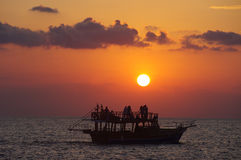 Sunset boat. Beautiful sunset boat in Side, Turkey Stock Image
