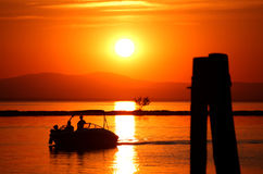 The Sunset and the Boat Royalty Free Stock Image