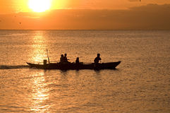 Sunset boat. Picture of a fisherman's boat going home royalty free stock photo