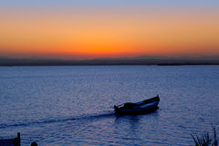 Sunset boat in Albufera lake Valencia Royalty Free Stock Photo