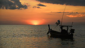 Sunset and boat at beach stock video footage