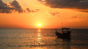 Sunset and boat at beach stock footage