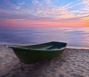 Sunset.Boat on coast. Royalty Free Stock Photo