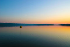 Sunset and boat in Cyprus lake, Tobermory Royalty Free Stock Photo