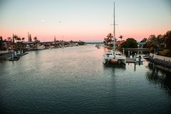 Sunset Boat Dock. Boat docked in the water during sunset stock images